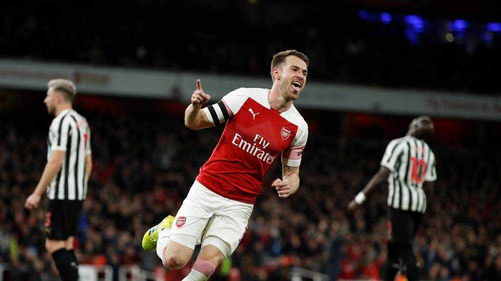 Aaron Ramsey celebrates after he scored against Newcastle