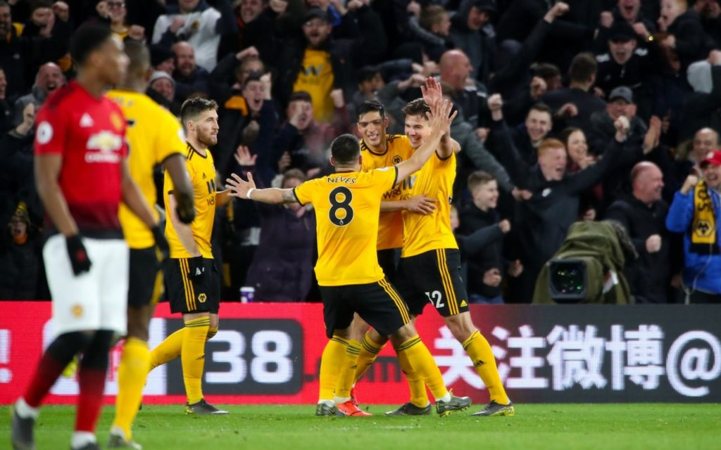Wolves players celebrate after beating Manchester United