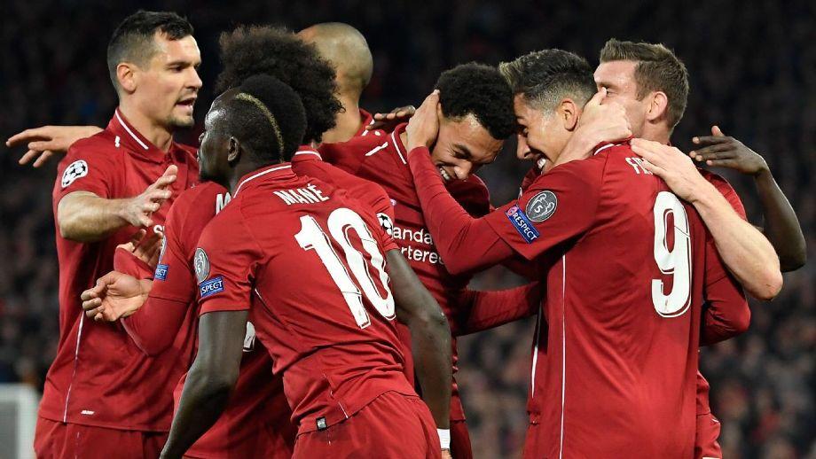 Liverpool players celebrate victory over Porto