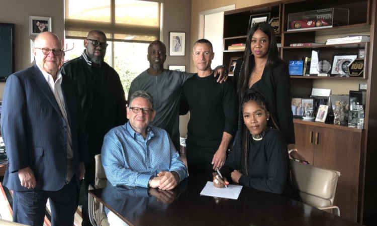 Tiwa Savage signing her record deal with Universal Music Group.