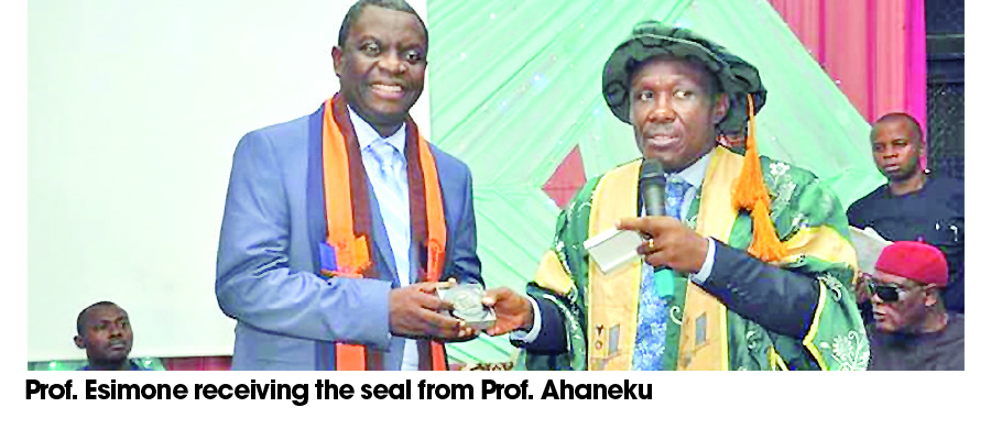 Prof Esimone receiving the seal   from Prof Ahaneku