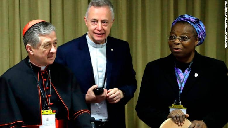 Sister Veronica Openibo stands next       to Chicago Archbishop Cardinal Blase J. Cupich, left, and Father Tomaz       Mavric at Vatican's conference on clergy sex abuse
