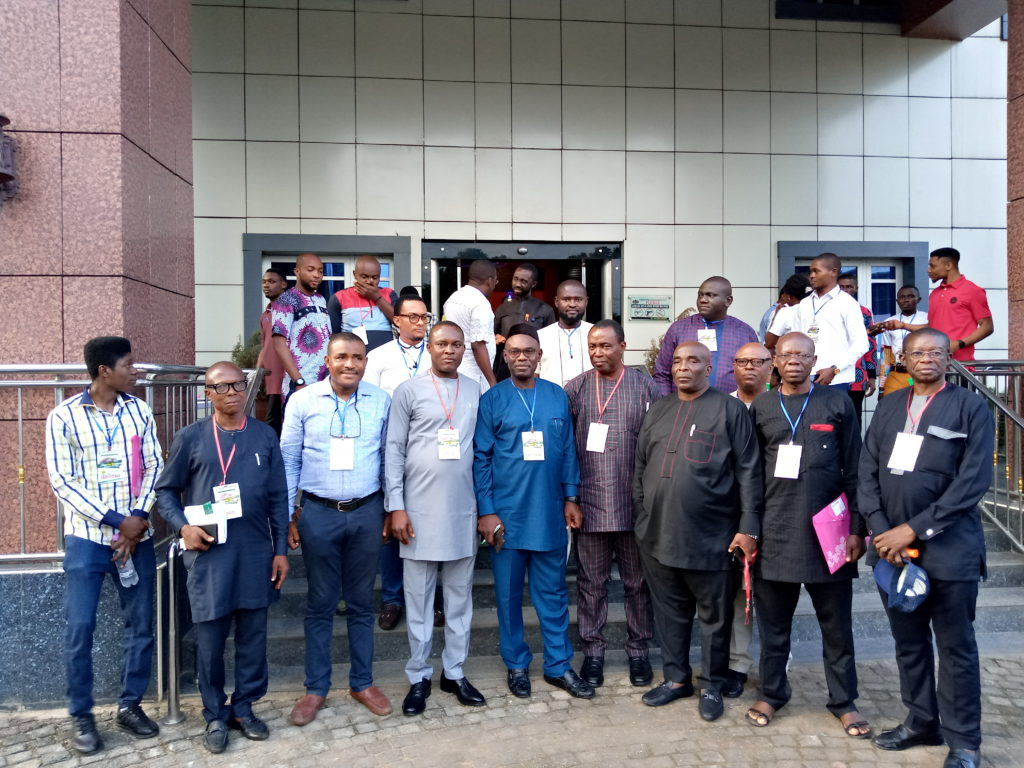 Arc. Mike Nwafor (Blue), the Chapter Chairman,  Arc Osita Paul Okafor (4th left) and other dignitaries