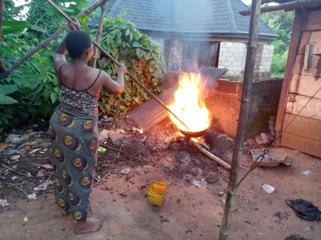 Mrs Ginika Owoh frying cashew at Awkunano Udi