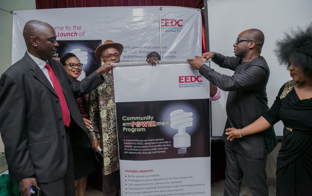 R-L: The Managing Director/CEO, EEDC, Mr. Okey Nwosu unveiling the Community Empowerment Program to guests during the launch, assisted by the Deputy Managing Director, Mr. Paul Okeke.
