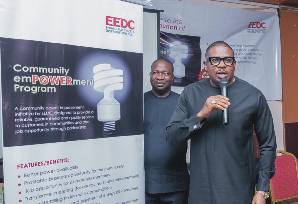 The Anambra State Commissioner for Public Utilities, Hon. Engr. Emeka Ezenwanne, who represented the Executive Governor, Chief Willie Obiano, unveiling Community Empowerment Program at the launch in company of the Head, Health, Safety & Environment, EEDC, Engr. Francis Iwu.