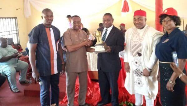 Chief Onyegu recieving the award